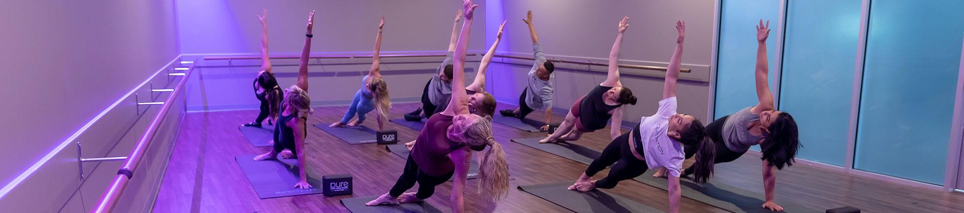 group class doing pilates