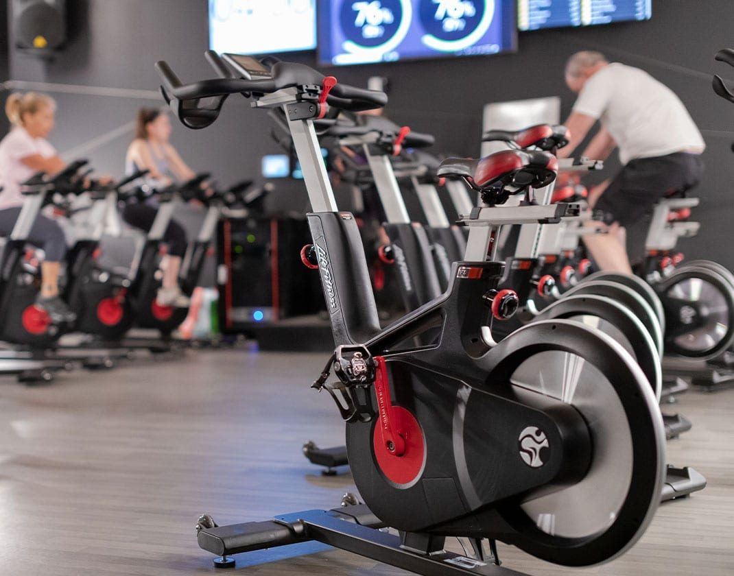 a close-up shot of a cycle machine in a group spin studio in the best gym near me
