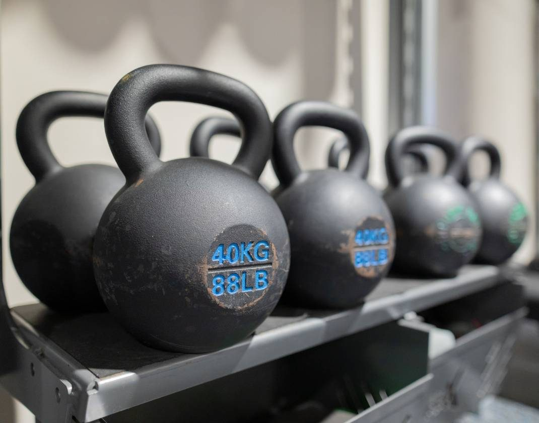 modern weight lifting equipment in clean modern gym near me