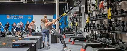woman working out in spacious bfitt60 training room