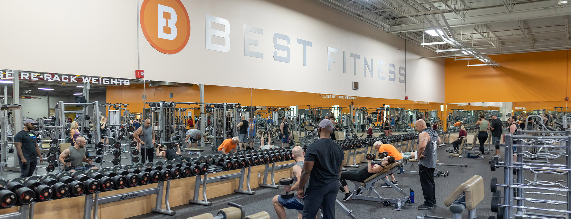 spacious gym and people working out in it