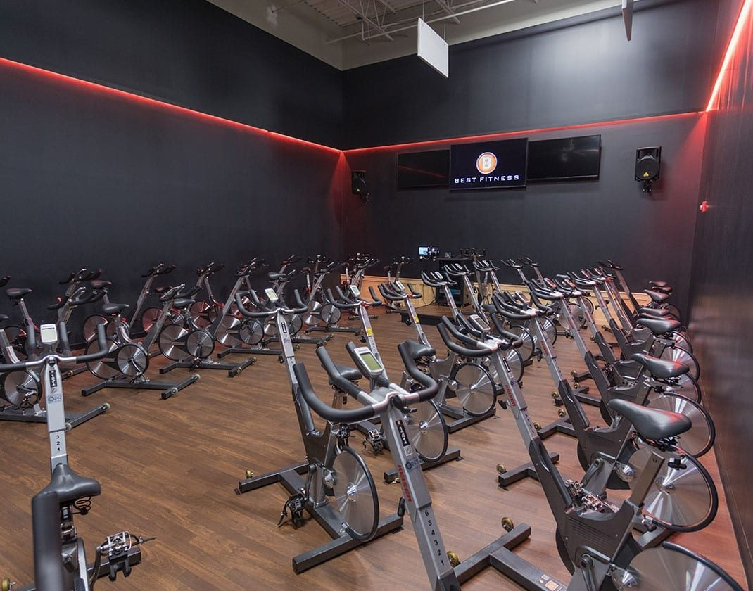 row of cycling machines at best gym near me