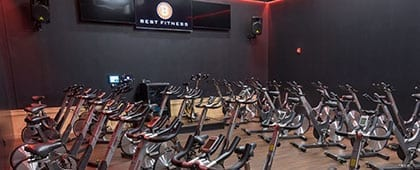 spacious cycle studio in modern gym near me