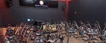 spacious cycle studio in modern gym near me