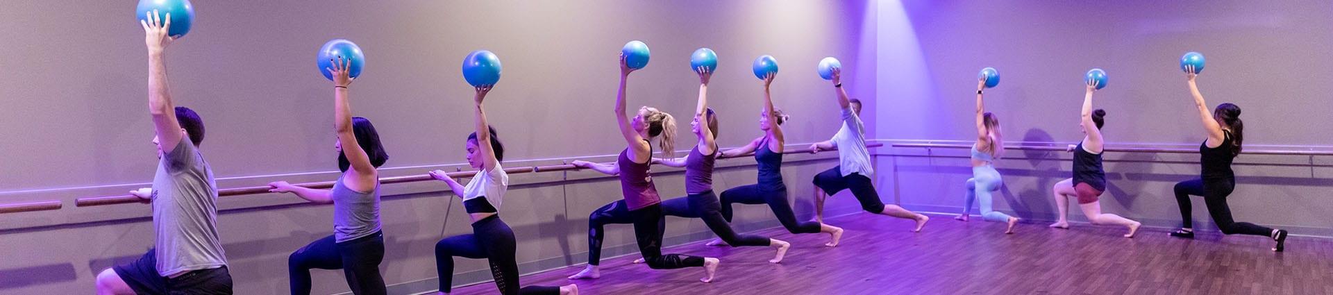 barre class in modern fitness studio